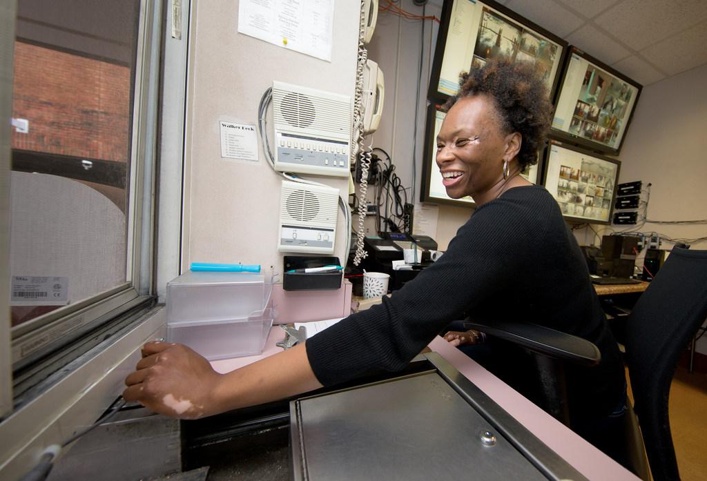 Tiffany Hunt, parking operations manager, works the cash register at Walker Deck.