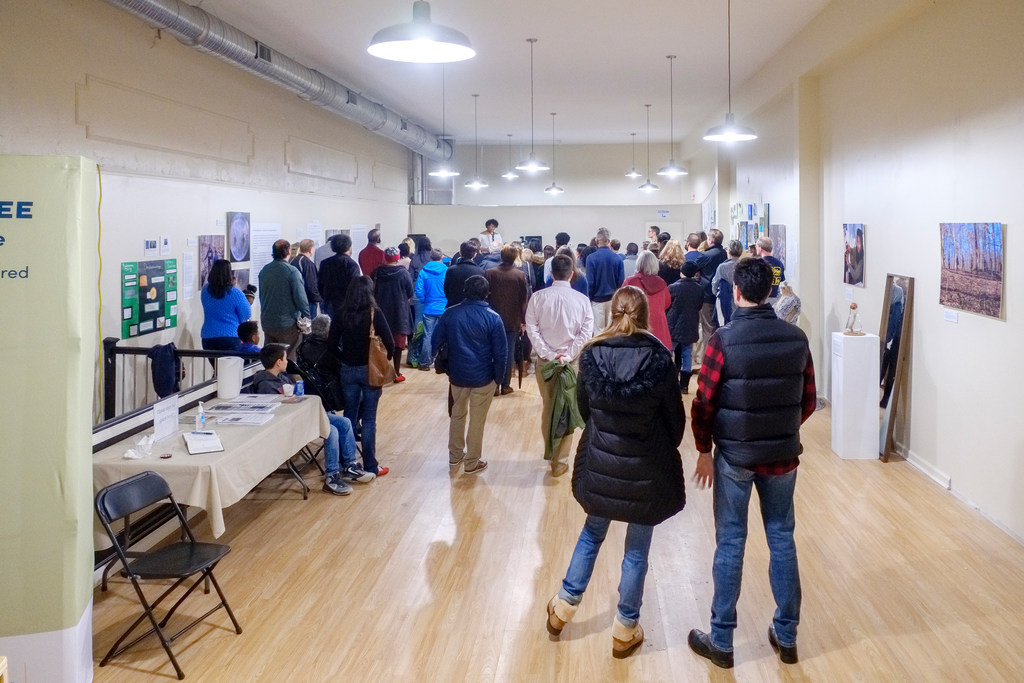 At Downtown Greensboro's First Friday event, a reception features performances and readings about the Underground Railroad Tree exhibition.