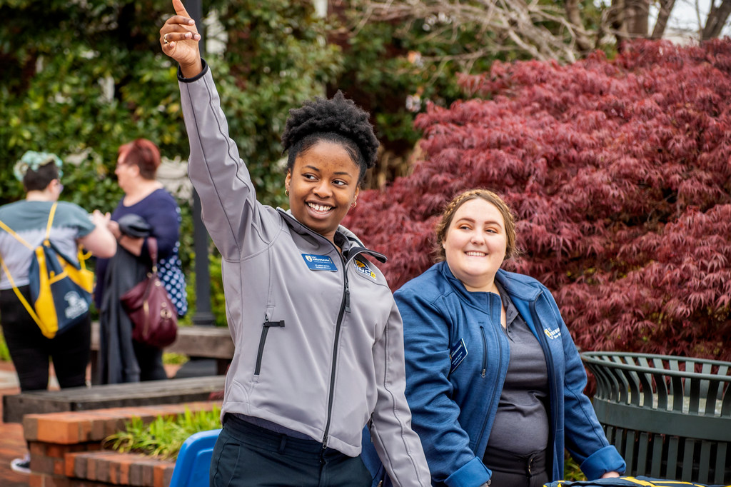 Claire King, an assistant director at the undergraduate admissions, and Maggie Leone, a Spartan Guide, welcome UNCG admitted students and their family members to the day's opening Destination UNCG event.