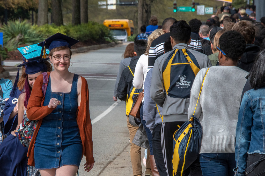 Brigid Meier, graduating in May with a BFA in theater education, passes by newly admitted students during the Destination UNCG open house.