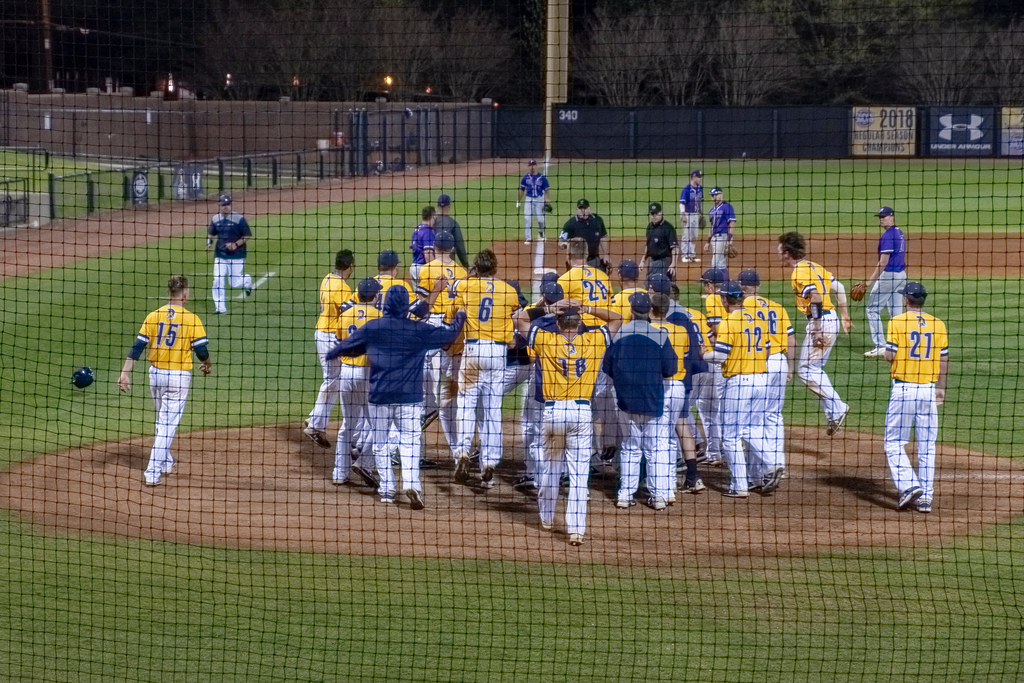 The UNCG baseball team celebrating